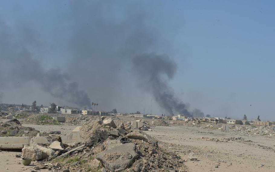 Columns of smoke rise from western Mosul, north of the city's airport, on Thursday, March 9, 2017. Islamic State fighters use the smoke to ward off airstrikes and surveillance aircraft as they fight to repel Iraqi forces closing in on their positions in the city, Iraq's second largest and the Islamist group's last major stronghold in the country.