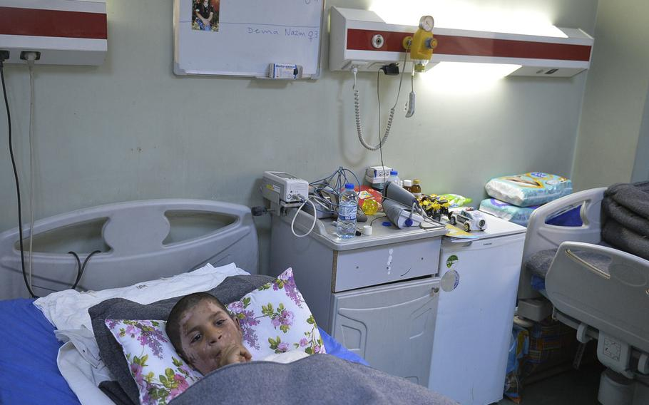 Yasiv, 11, wounded with burns from an apparent chemical attack in east Mosul in early March, recuperates in a hospital bed at an emergency hospital in Irbil on Saturday, March 11, 2017.