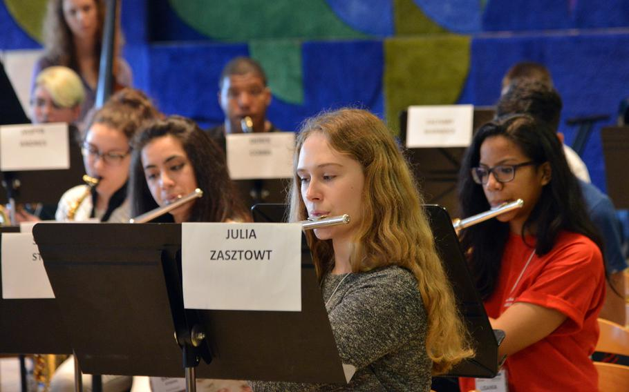 Ramstein's Julia Zasztowt plays the flute along with the rest of the honors band as they rehearse a number at the DODEA-Europe Honors Music Festival, Tuesday, March 14, 2017.