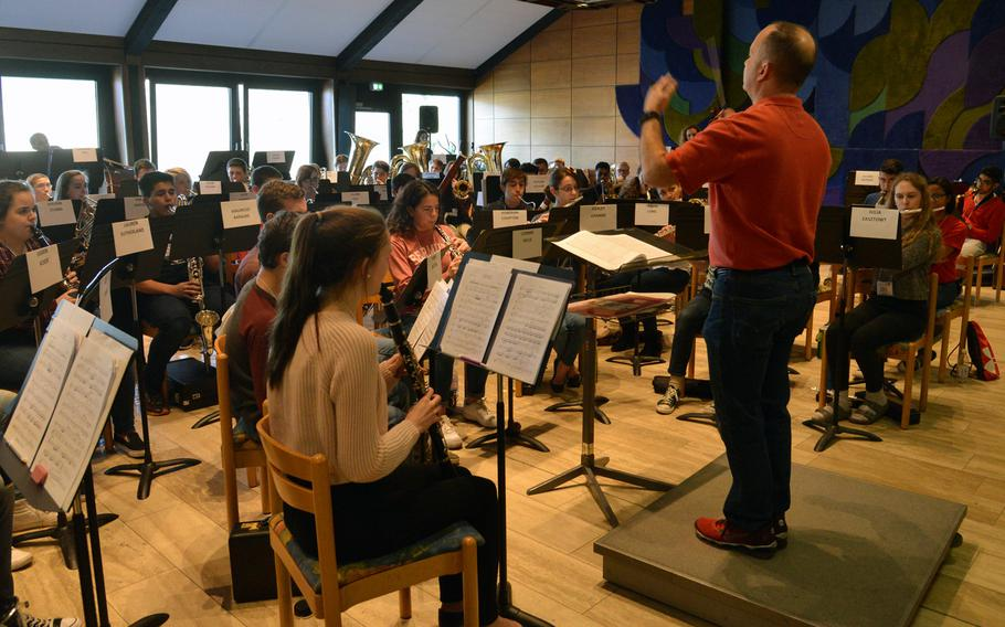 Don Schofield Jr. conducts the honors band as they rehearse a number at the DODEA-Europe Honors Music Festival, Tuesday, March 14, 2017.