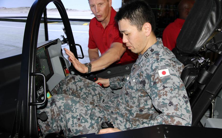 A member of the Japan Self-Defense Forces tries out an F-35 fighter-jet simulator during a two-day symposium at Joint Base Pearl Harbor-Hickam, Hawaii, Tuesday, March 14, 2017.