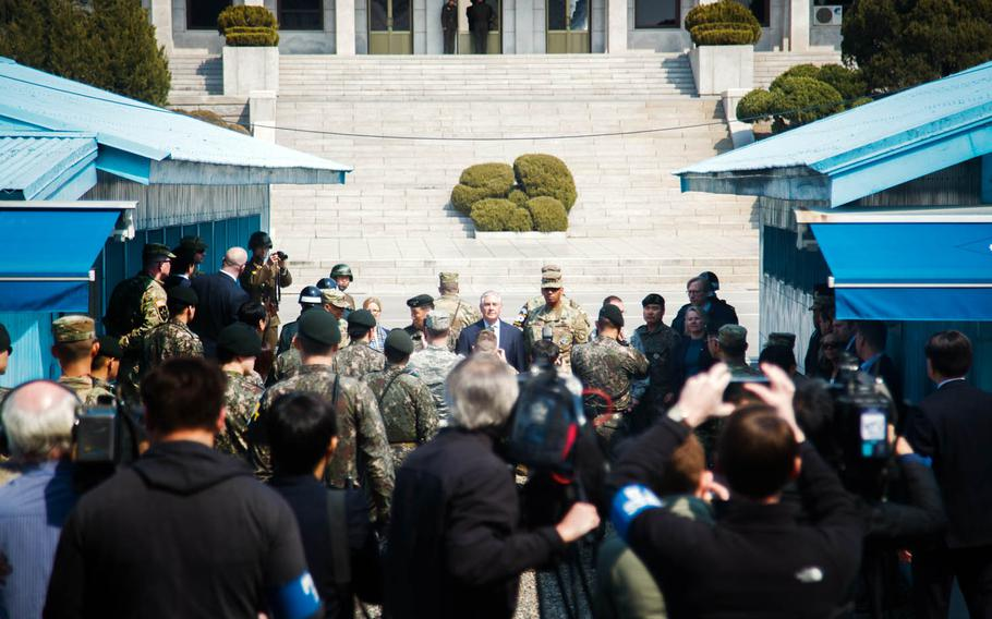 Secretary of State Rex Tillerson stands with U.S. and South Korean military officials on the demarcation line between North and South Korea at the Joint Security Area of the Demilitarized Zone, Friday, March 17, 2017.