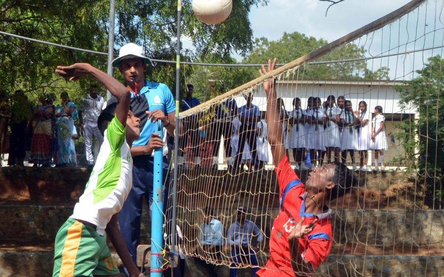 Skilled Sri Lankan teens play volleyball alongside U.S. servicemembers at a school in the village of Nonagama, on Sri Lanka's south coast. The game was part of Pacific Partnership 2017, a humanitarian and disaster-relief planning exercise.