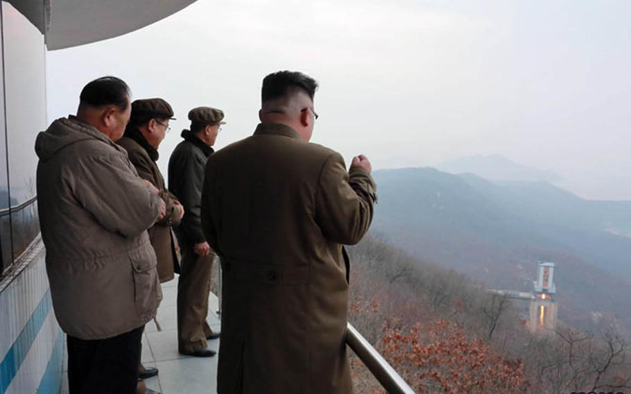North Korean leader Kim Jong Un, far right, observes a rocket-engine test in this undated photo from the Korean Centreal News Agency.