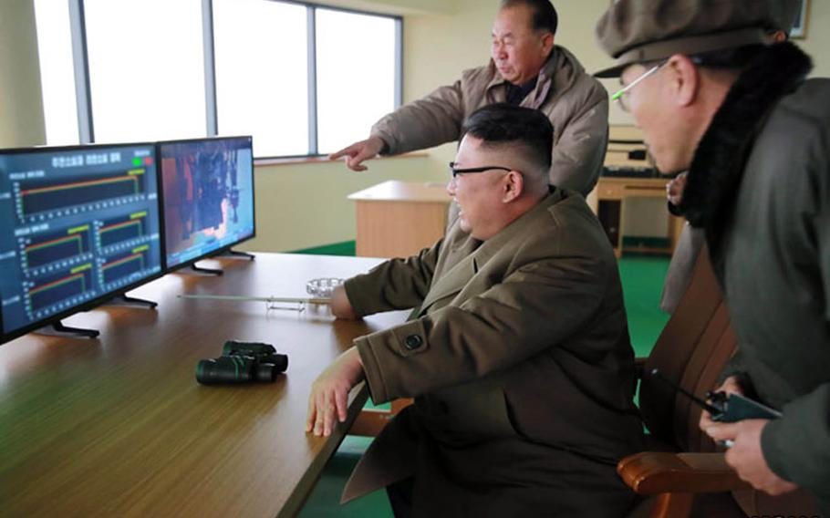 North Korean leader Kim Jong Un, seated, observes a rocket-engine test in this undated photo from the Korean Centreal News Agency.