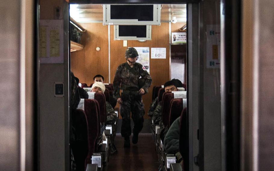 A South Korean medic evaluates casualties aboard a South Korean medical train as it travels from Seoul to Suwon, South Korea, Wednesday, March 15, 2017.