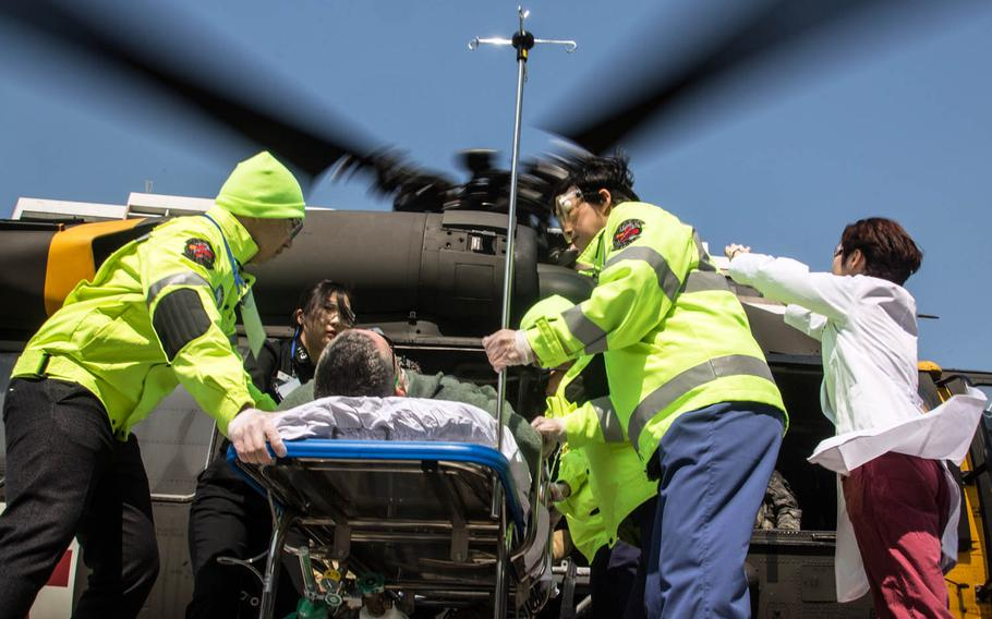 A UH-60 Blackhawk helicopter delivers a simulated casualty to Ajou University Hospital, Suwon, South Korea, Wednesday, March 15, 2017.