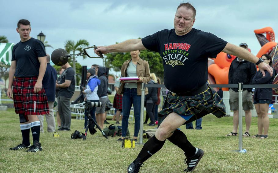 A competitor builds up momentum for the weight throw contest at the Torii Station Highland Games in Okinawa, Japan, Saturday, March 18, 2017.