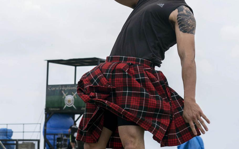 A competitor takes part in the weight for height event during the Torii Station Highland Games in Okinawa, Japan, Saturday, March 18, 2017.