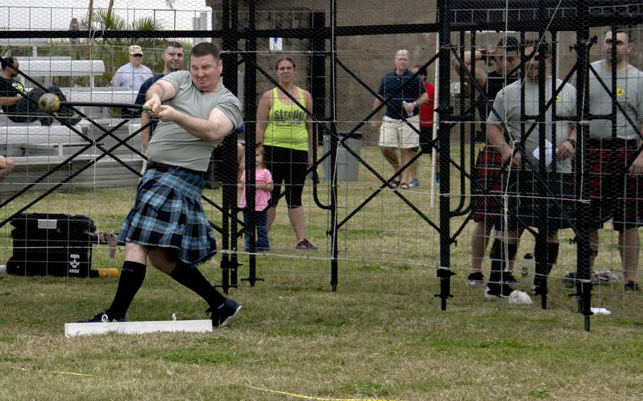 A man competes in the hammer throw during in the Torii Station Highland Games in Okinawa, Japan, Saturday, March 18, 2017.