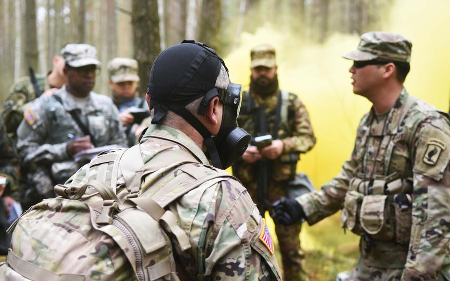 Instructors at the Expert Field Medical Badge training explain decontamination procedures for chemical warfare to the candidates. More than 200 candidates registered for the course, but fewer than 50 are anticipated to earn the badge.