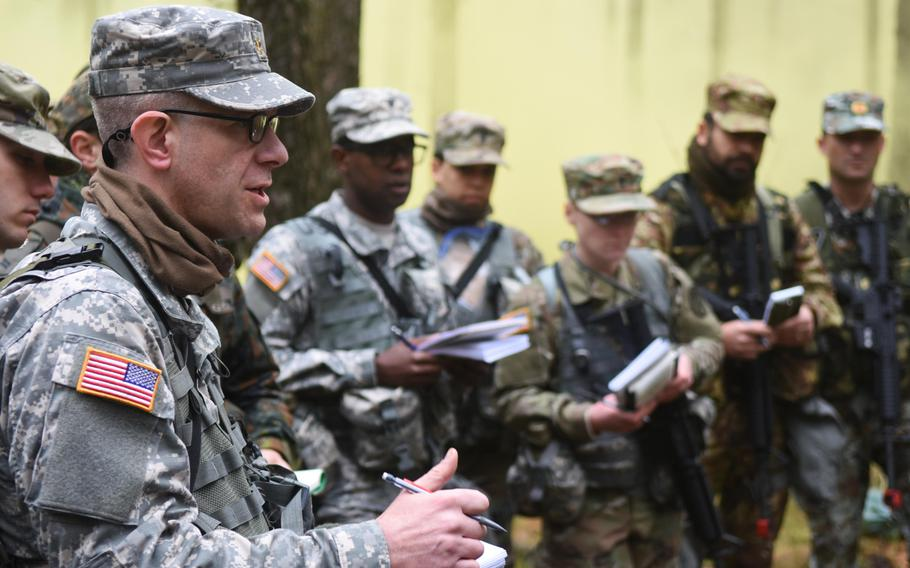 A student at the Expert Field Medical Badge training at Grafenwoehr, Germany, asks a question during the hazardous materials portion of the training, Monday, March 20, 2017. The students have one week to train before they conduct their test to earn the highly sought after badge.