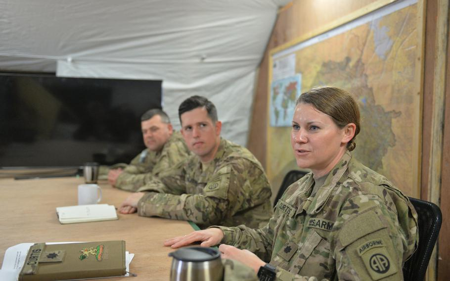 Lt. Col. Elizabeth Curtis discusses efforts to resupply U.S. and Iraqi forces while 1st Sgt. Greg Bristley, left, and Capt. Zach Beecher look on during a press event at Qayara Airfield West on Friday, March 17, 2017.