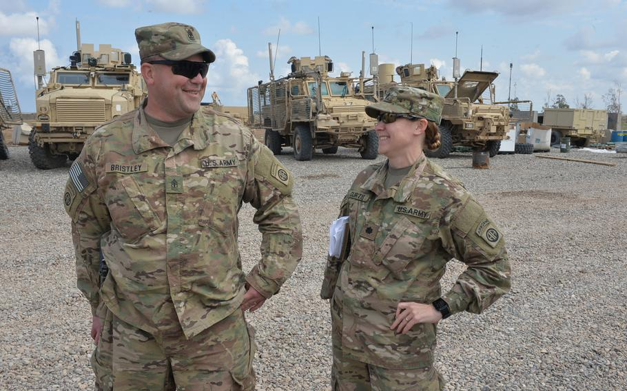 Pictured here sharing a laugh on Friday, March 17, 2017 at Qayara Airfield West are 1st Sgt. Greg Bristley and Lt. Col. Elizabeth Curtis. Curtis, one of a few high-ranking female servicemembers on the base, said that while more opportunities exist now for women in the military, the focus should be on their skills, not their sex.