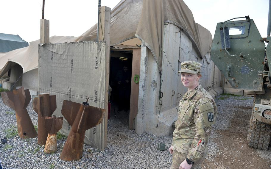 Platoon commander and 1st Lt. Mary Floyd stands near a structure that serves as the living quarters for the soldiers of ''Odin'' battery at Qayara Airfield West, pictured here on Friday, March 17, 2017. Floyd, a field artillery officer, said she loves to fire rockets, but she welcomed Army rules allowing women to serve in cannon batteries now, too.