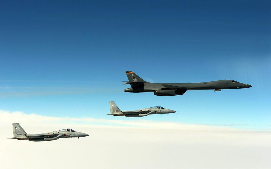 An Air Force B-1B Lancer flies in formation near Japan with Japan Air Self-Defense Force F-15s, Tuesday, March 21, 2017.