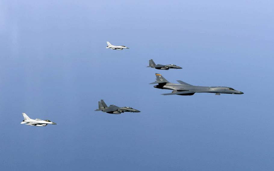 An Air Force B-1B Lancer flies in formation near the Korean peninsula with South Korean F-15Ks and F-16s, Tuesday, March 21, 2017.