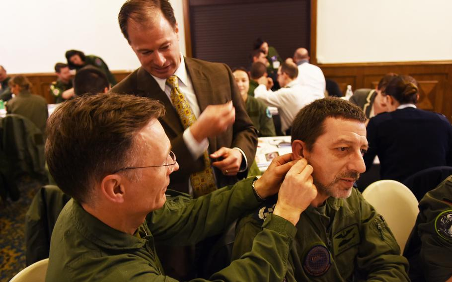 Thomas Piazza, the director of the Air Force's acupuncture program at Joint Base Andrews in Maryland, instructs during the battlefield acupuncture workshop on Tuesday, March 21, 2017, at Ramstein Air Base, Germany.