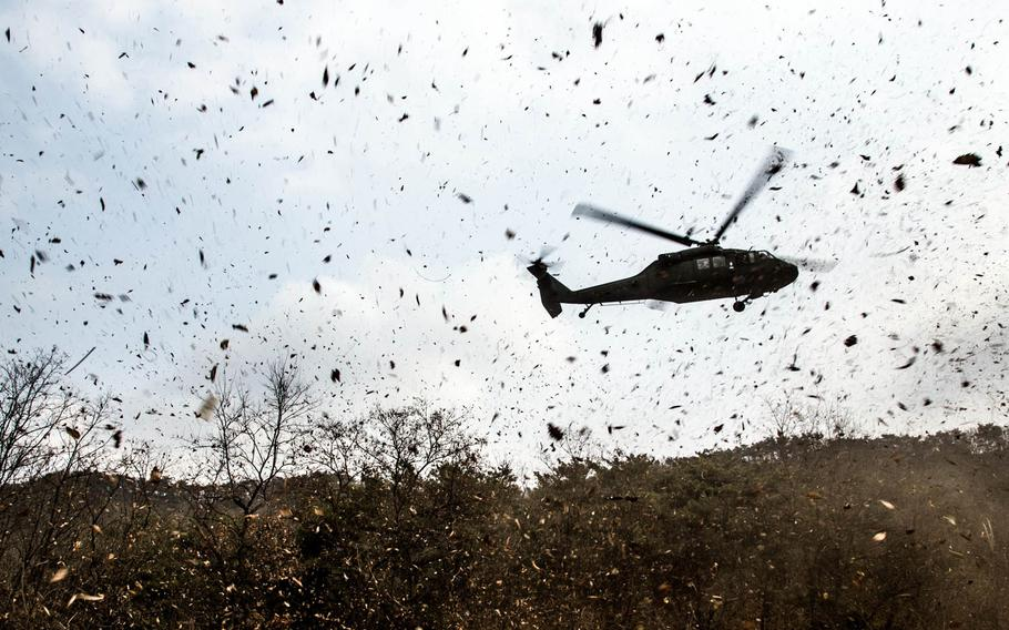 A helicopter lands at the Rodriguez Live Fire Range in Paju, South Korea, Tuesday, March 21, 2017.