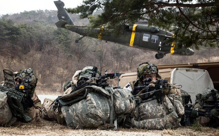 Soldiers from the 1st Armored Brigade Combat Team, 1st Infantry Division protect a landing zone during training at Rodriguez Live Fire Range in Paju, South Korea, Tuesday, March 21, 2017.