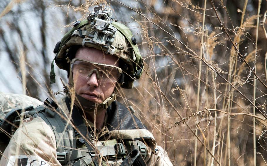 A soldier from the 1st Armored Brigade Combat Team, 1st Infantry Division climbs a hill during training at Rodriguez Live Fire Range in Paju, South Korea, Tuesday, March 21, 2017.