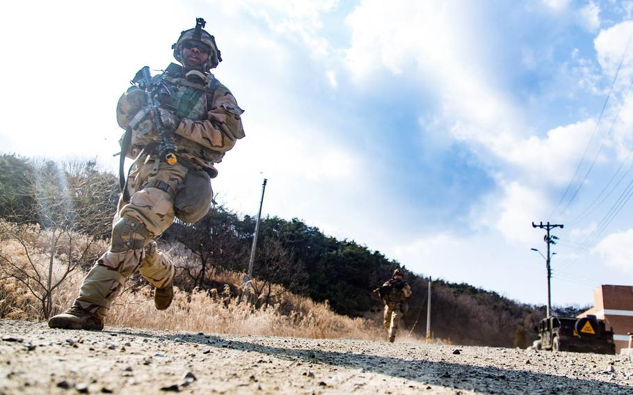 Soldiers from the 1st Armored Brigade Combat Team, 1st Infantry Division storm a mock village during training at Rodriguez Live Fire Range in Paju, South Korea, Tuesday, March 21, 2017.