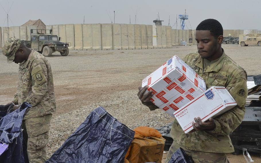 Spc. Telvin Boseman, 22, of Charlotte, N.C., sorts care packages from a mail delivery at Qayara Airfield West, Iraq, March 17, 2017. Mail is one of the few morale boosters on base here, about 40 miles south of Mosul, where troops are supporting an ongoing campaign to oust Islamic State militants from Mosul.