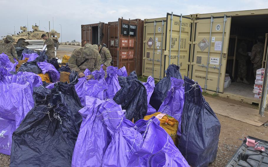 Soldiers of the 678th Adjutant General Company Postal Platoon sort mail at Qayara Airfield West, Iraq, March 17, 2017. Troops say any care package from home is a good one, and they often receive them from strangers through groups such as ''Adopt a Platoon.'' Mail arrives here about once every two weeks.