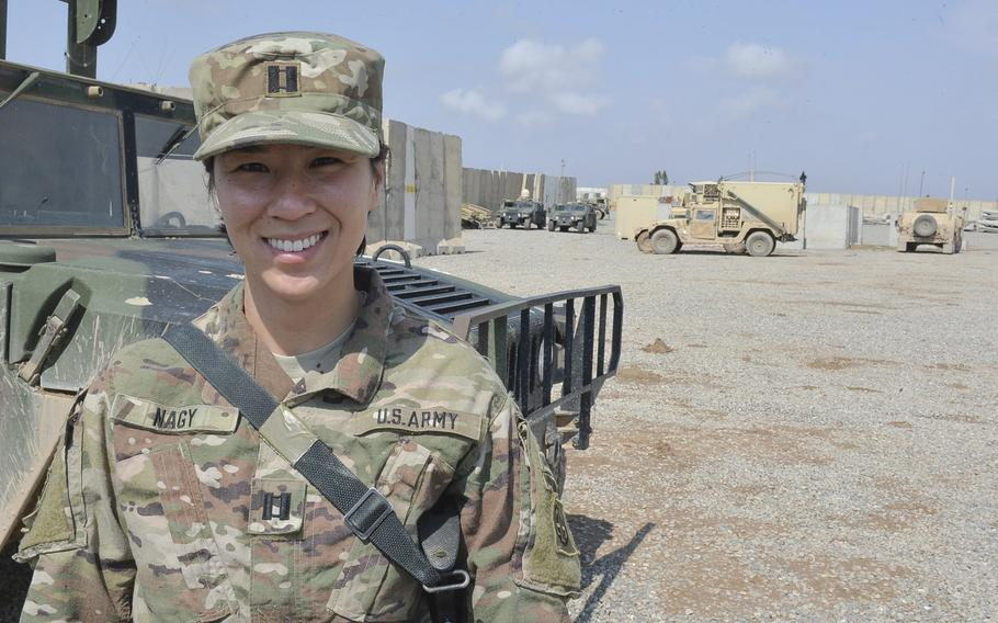 Capt. Anne Nagy, battalion planner with the 37th Brigade Engineer Battalion of the 82nd Airborne Division's 2nd Brigade Combat Team, is pictured here, March 17, 2017, on Qayara Airfield West. Nagy, whose job is to plan the ongoing build-out of the base, said her job is like the city-building computer game ''SimCity.''