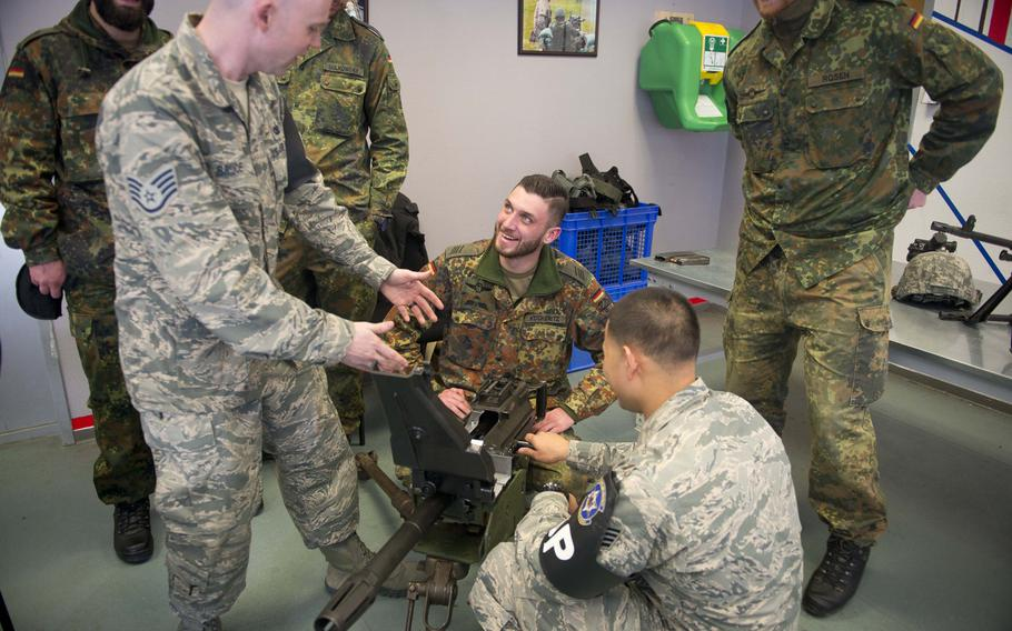 Staff Sgts. Caleb Bruce, left, and Andrew Deleon-Guerrero show Spc. Kevin Kockeritz how to operate a Mk 19 grenade launcher in Kaiserslautern, Germany, on Thursday, March 23, 2017.