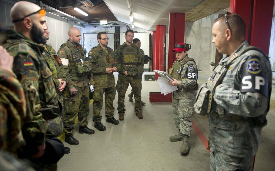 Tech Sgt. Kellie Sawn, second from right, gives safety instructions to German soldiers in Kaiserslautern, Germany, on Thursday, March 23, 2017.