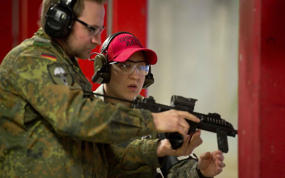 Cpl. Klaus Schmidt, left, prepares an MP7 for Tech Sgt. Kellie Sawn in Kaiserslautern, Germany, on Thursday, March 23, 2017.