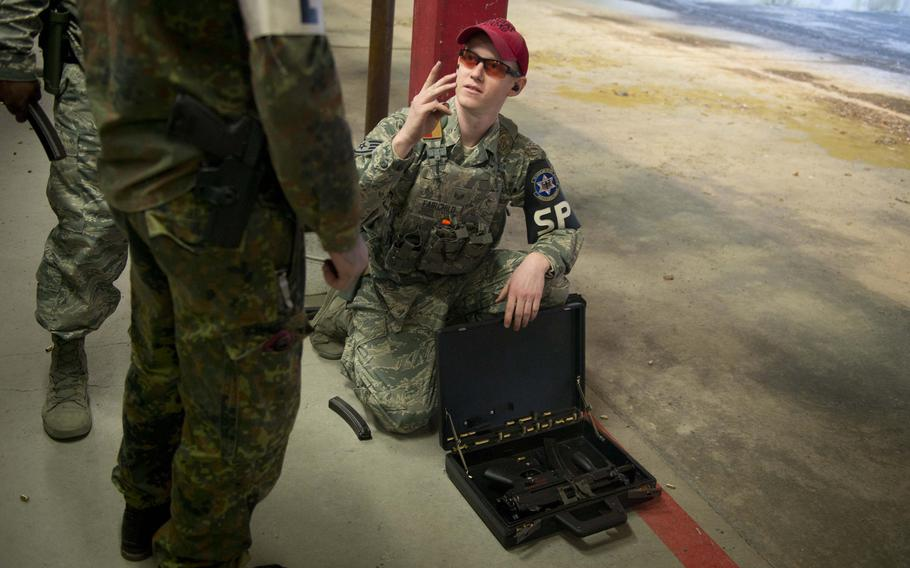 Staff Sgt. Shane Fairchild prepares an MP5K operational briefcase for a German soldier in Kaiserslautern, Germany, on Thursday, March 23, 2017.