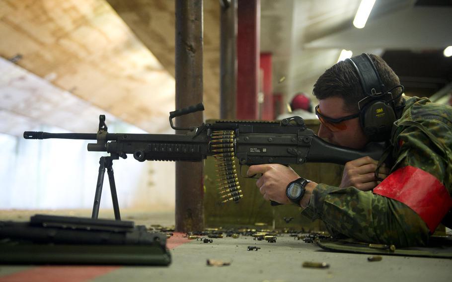 Cpl. Sebastian Sulkowsky fires an M249 in Kaiserslautern, Germany, on Thursday, March 23, 2017.