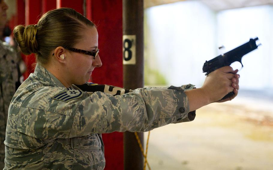Staff Sgt. Briana Stanley fires an M9 in Kaiserslautern, Germany, on Thursday, March 23, 2017.