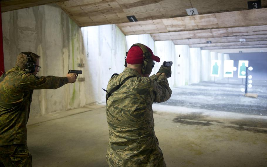 Staff Sgt. Caleb Bruce, right, and Cpl. Klaus Schmidt have a friendly competition while shooting a target in Kaiserslautern, Germany, on Thursday, March 23, 2017.