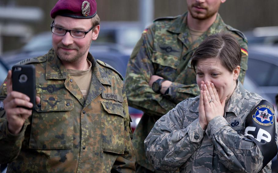 Cpl. Klaus Schmidt, left, and Tech Sgt. Kellie Sawn watch a German soldier testing the effects of a Tazer in Kaiserslautern, Germany, on Thursday, March 23, 2017.