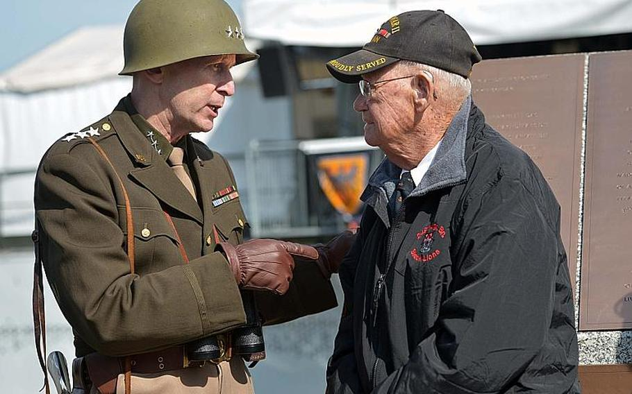 Lt. Gen. George S. Patton, aka Thomas Goode, talks to World War II veteran Robert Shelato at the dedication ceremony for the World War II Rhine River crossing monument in Nierstein, Germany, Saturday, March 25, 2017. Shelato, with the 249th Engineer Battalion, bridged the Rhine in March 1945, letting Patton's 3rd Army cross into the heart of Germany. Goode is a teacher at Ramstein High School.