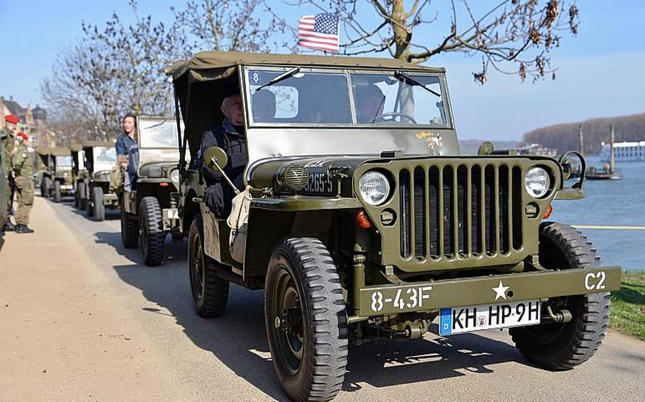 A parade of World War II vehicles brought the distinguished visitors to the site of the dedication ceremony for the Rhine River crossing monument in Nierstein, Germany, Saturday, March 25, 2017.