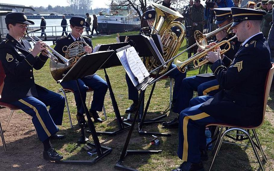 The U.S. Army Europe brass quintet entertained with World War II-era music, besides playing the German and American national anthems at the Rhine River crossing monument in Nierstein, Germany, Saturday, March 25, 2017.