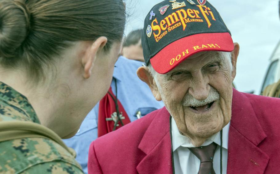 Battle of Iwo Jima veteran George Cattalona is greeted by Marines upon arriving on the island, now known as Iwo To, Saturday, March 25, 2017.