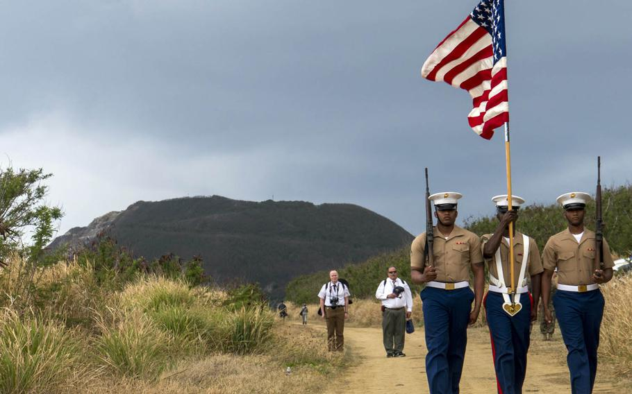 Marines from the III Marine Expeditionary Force on Okinawa take part in a ceremony marking the 72nd anniversary of the Battle of Iwo Jima, Saturday, March 25, 2017.