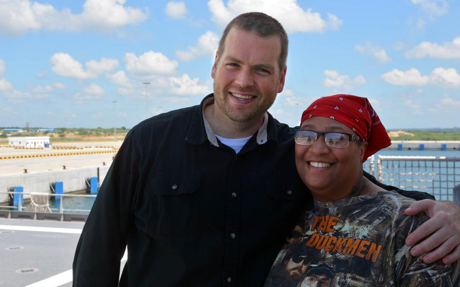Patrick Picker and Lashawnta Jenkins pose aboard the USNS Fall River in Hambantota, Sri Lanka, March 8, 2017. The former servicemembers work for as civilian mariners for the Navy's Military Sealift Command.