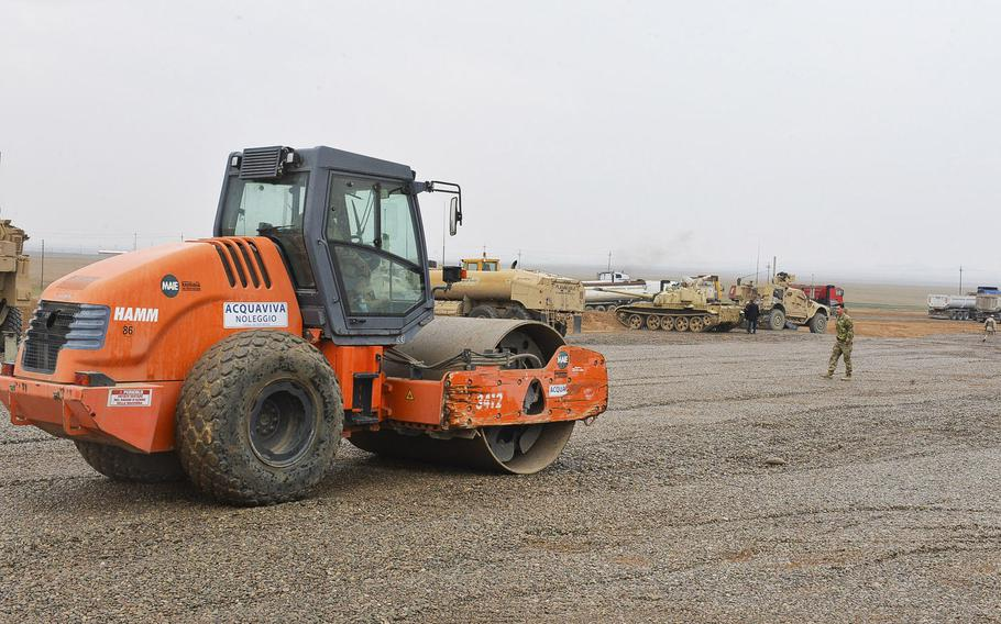 A soldier with the 37th Brigade Engineer Battalion of the 82nd Airborne Division's 2nd Brigade Combat Team is pictured here on March 2, 2017, operating a road roller to compact gravel that's used to prevent mud from bogging down U.S. troops on a tactical base south of Mosul, Iraq.