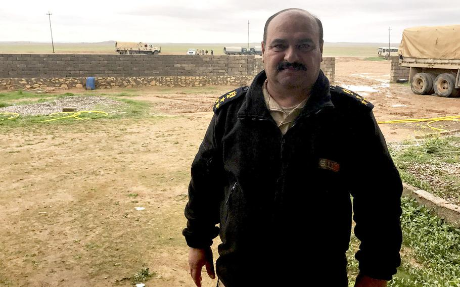 Brig. Gen. Ahmed Shaker, chief of staff of Iraq's 9th Armored Division, is pictured here on a muddy Iraqi base south of Mosul, near one built by U.S. forces advising the Iraqis and supporting them with intelligence and precision strike capabilities.