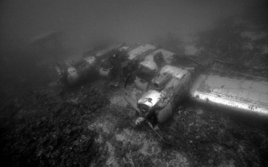 The upside-down wing section from a PBM-3D Mariner patrol bomber plane lays where it sank after plunging into Kwajalein Lagoon, Feb. 16, 1944.