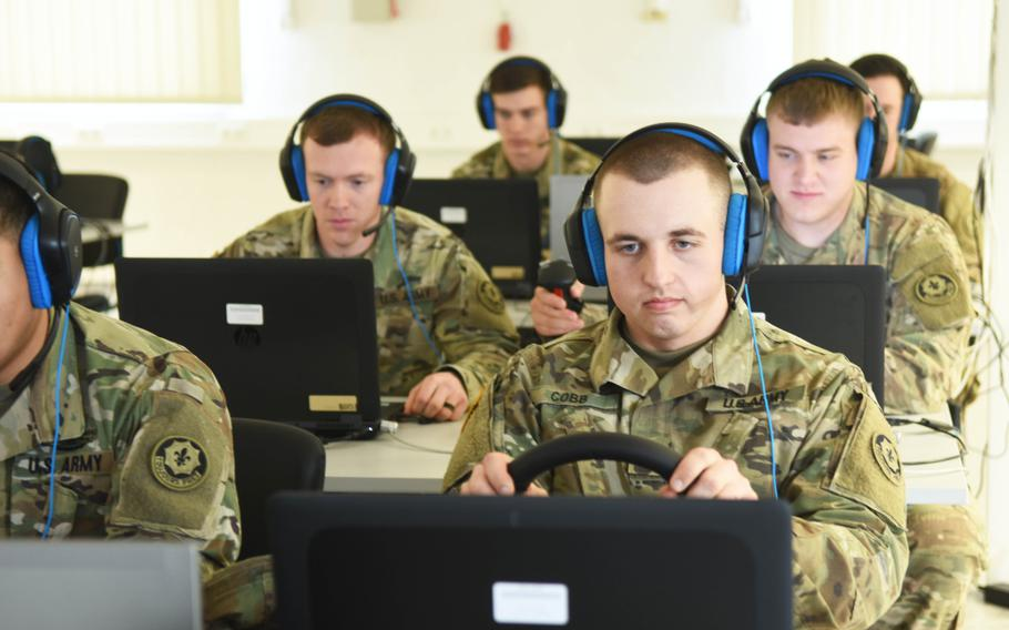 Soldiers with the Army's 2nd Cavalry Regiment virtually train with the upcoming Dragoon Stryker, equipped with a larger 30 mm cannon, at Grafenwoehr, Germany, Thursday, March 30, 2017.