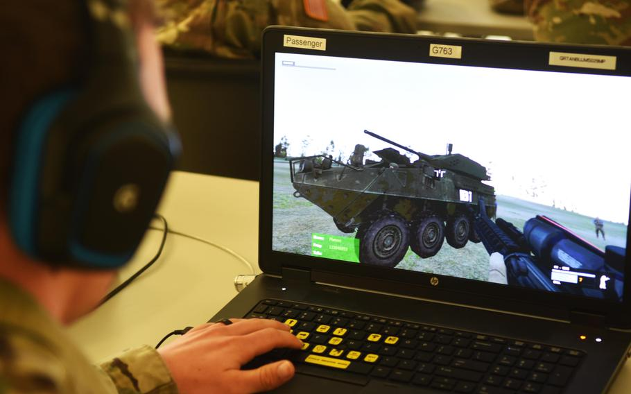 A soldier with the Army's 2nd Cavalry Regiment virtually train with the upcoming Dragoon Stryker, equipped with a larger 30 mm cannon, at Grafenwoehr, Germany, Thursday, March 30, 2017.