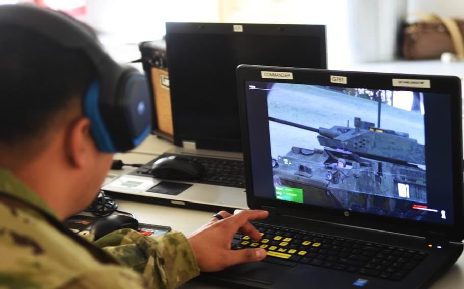 A soldier with the Army's 2nd Cavalry Regiment virtually train with the upcoming Dragoon Stryker, equipped with a larger 30mm cannon, at Grafenwoehr, Germany, Thursday,March 30, 2017.