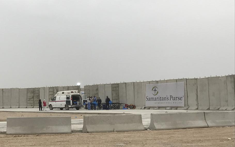 An ambulance brings the wounded to the Samaritan's Purse field hospital east of Mosul, Iraq, March 17, 2017. Officials say they've treated more than 900 people, many women in children, wounded in the offensive to retake the city from Islamic State fighters, who have held it since 2014.